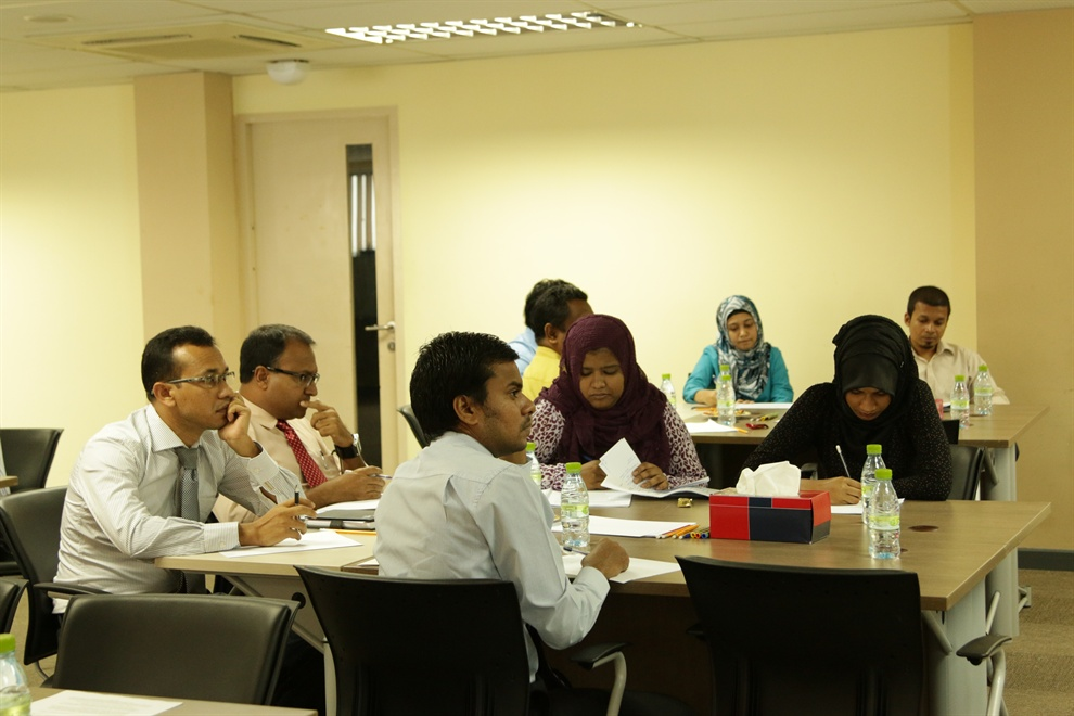 Participants working on a workshop exercise